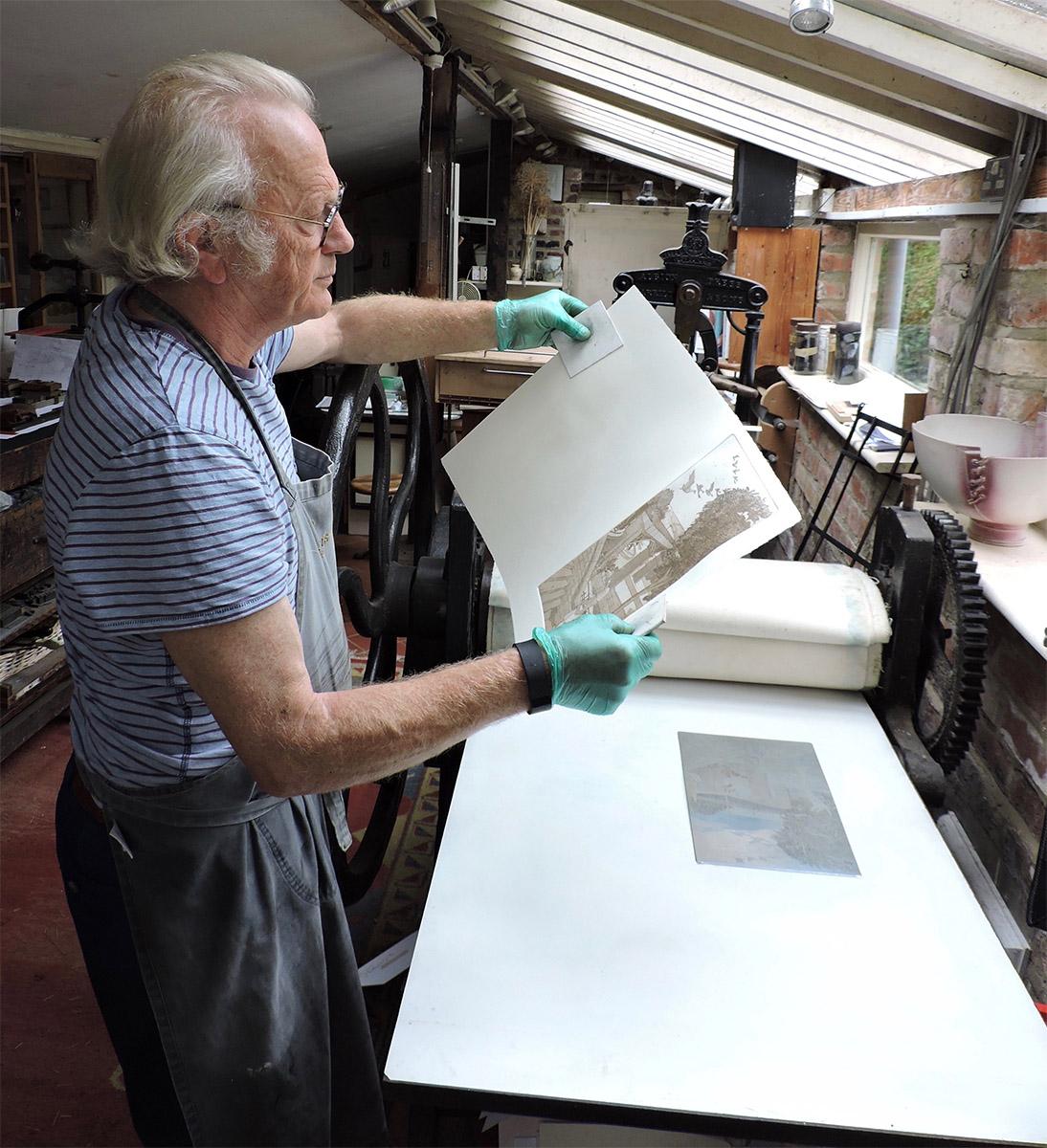 The Secretary Michael Atkin in his workshop printing an original print.