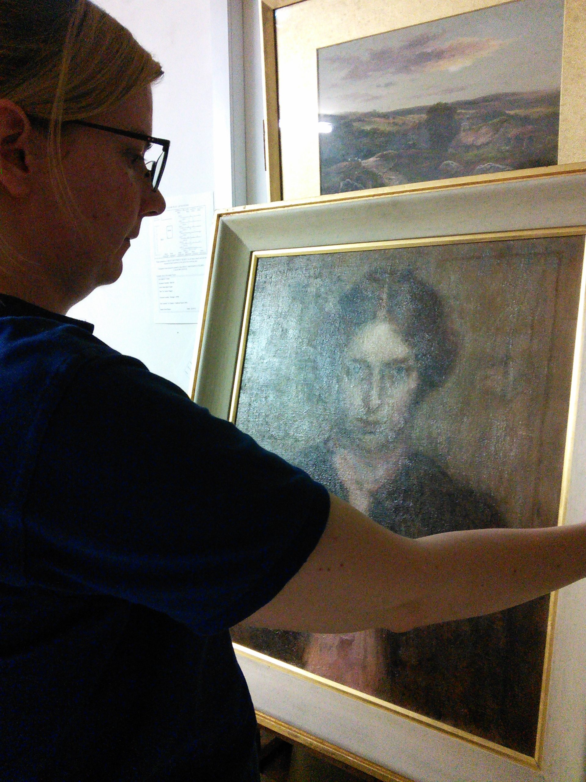 "Pannett Art Gallery team member Lisa admires the painting ""Laura"" which the gallery recently acquired."